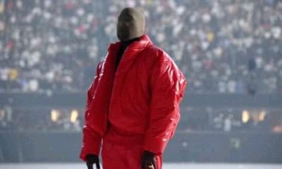 Kanye West was photographed at a football game with tights on his head, Following the record listening session