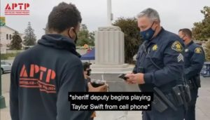 Taylor swift song played by a cop to disrupt a protest video
