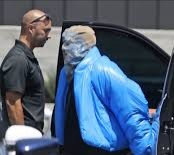 Kanye West wears a full face mask to the star-studded Balenciaga event