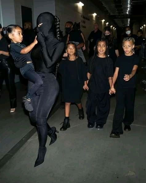 Kim Kardashian looks edgy in all black as she poses with fake tattooed daughter North and little Chicago at ex Kanye West's Donda listening party