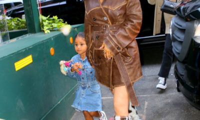 Kylie Jenner gently cradles baby bump as she grabs lunch with daughter Stormi during New York Fashion Week