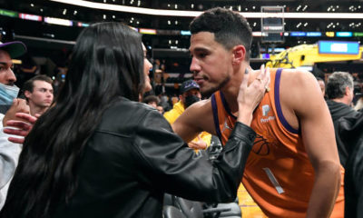 Kendall Jenner and Devin Booker Just Had a Rare PDA Moment Kissing at a Basketball Game